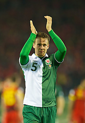 BRUSSELS, BELGIUM - Tuesday, October 15, 2013: Wales' Chris Gunter applauds the supporters after making his 50th appearance during the 2014 FIFA World Cup Brazil Qualifying Group A match against Belgium at the Koning Boudewijnstadion. (Pic by David Rawcliffe/Propaganda)