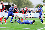 Bayo Akinfenwa of AFC Wimbledon makes it 2-3 straight from kick off during the Sky Bet League 2 match between AFC Wimbledon and Morecambe at the Cherry Red Records Stadium, Kingston, England on 17 October 2015. Photo by Stuart Butcher.