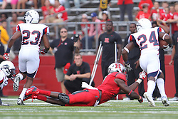 Sept 8, 2012; Piscataway, NJ, USA; Howard Bison defensive back Julien David (24) returns an interception by Rutgers Scarlet Knights quarterback Gary Nova (15) during the first half at High Point Solutions Stadium.