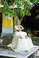 A clothed statue at Rambut Siwi, Bali, Indonesia.