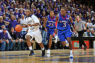 Jan 30, 2008; Manhattan, KS, USA; Kansas State Wildcats guard Jacob Pullen (0) drives the ball up court past Kansas Jayhawks defenders Russell Robinson (3) and Brandon Rush (25) in the second half at Bramlage Coliseum in Manhattan, KS. Kansas State upset the 2nd ranked Kansas Jayhawks 84-75. Mandatory Credit: Peter G. Aiken-US PRESSWIRE
