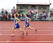 Two Irondequoit runners compete in the 1,600-meter run at the His and Her track and field invitational at Penfield High School on Saturday, April 26, 2014.