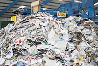 Pile of recycled paper in factory