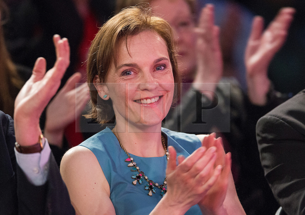 © Licensed to London News Pictures . 06/05/2015 . Leeds , UK . JUSTINE THORNTON , Ed Miliband's wife , applauds a speech by the leader of the Labour Party , Ed Miliband at an election rally at Leeds City Museum , on the eve of polls opening for the 2015 British general election . Photo credit : Joel Goodman/LNP