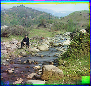 What Russian Empire Looked Like Before 1917… In Colour<br /> <br /> <br /> The Sergei Mikhailovich Prokudin-Gorskii Collection features colour photographic surveys of the vast Russian Empire made between ca. 1905 and 1915. Frequent subjects among the 2,607 distinct images include people, religious architecture, historic sites, industry and agriculture, public works construction, scenes along water and railway transportation routes, and views of villages and cities. An active photographer and scientist, Prokudin-Gorskii (1863-1944) undertook most of his ambitious colour documentary project from 1909 to 1915. <br /> <br /> Photo Shows; Sergei Mikhailovich Prokudin-Gorskii sits beside the Karolitskhali River. (1912)<br /> ©Library of Congress/Prokudin-Gorskii/Exclusivepix Media