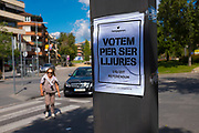"""We vote for being free"" Catalonia Referendum Posters on Rambla del Cellar near the City Hall of Sant Cugat, Barcelona, Catalonia. The Spanish authorities have clamped down on the publishing of referendum materials by the Catalan independence movement, so ordinary people have started printing and distribution posters."