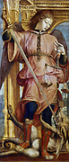 St Michael the Archangel fighting dragon with sword. In left hand he holds balance to weigh men's souls. Bernadino Martini, known as Zenale (1436-1526) Italian artist.