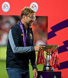 HONG KONG, CHINA - Saturday, July 22, 2017: Liverpool's manager Jürgen Klopp is walks past the trophy after beating Leicester City 2-0 during the Premier League Asia Trophy final match between Liverpool and Leicester City at the Hong Kong International Stadium. (Pic by David Rawcliffe/Propaganda)