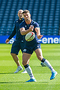 Adam Hastings gets a pass away during the Scotland Rugby training run ahead of their match against France at BT Murrayfield Stadium, Edinburgh, Scotland on 23 August 2019.