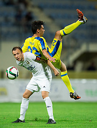 Matic Igor of FK Cukaricki vs Horvat Lucas Mario of NK Domzale during 1st Leg football match between NK Domzale (SLO) na FC Cukaricki (SRB) in 1st Round of Europe League 2015/2016 Qualifications, on July 2, 2015 in Sports park Domzale,  Slovenia. Photo by Vid Ponikvar / Sportida