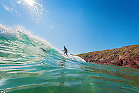 Surfer in water<br /> Westdale Bay<br /> Pembrokeshire<br /> South<br /> Surfing<br /> Activities and Sports
