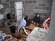 "Sept. 28, 2009 -- TANJONG DATO, THAILAND: Muslim women chat in a small corner store in the Muslim village of Tanjong Dato, in the province of Pattani, Thailand. Everybody in the village is Muslim and they say they have no problems, but the roads around the village leading to the provincial capital of Pattani are too dangerous for them to use once it gets dark. Thailand's three southern most provinces; Yala, Pattani and Narathiwat are often called ""restive"" and a decades long Muslim insurgency has gained traction recently. Nearly 4,000 people have been killed since 2004. The three southern provinces are under emergency control and there are more than 60,000 Thai military, police and paramilitary militia forces trying to keep the peace battling insurgents who favor car bombs and assassination.   Photo by Jack Kurtz / ZUMA Press"