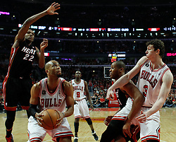 15.05.2011, UNITED CENTER, CHICAGO, USA, NBA, Chicago Bulls vs Miami Heat, im Bild Taj Gibson (2-L) goes to the basket against Miami Heat in game 1 of the NBA Eastern Conference Championships at the United Center in Chicago, EXPA Pictures © 2011, PhotoCredit: EXPA/ Newspix/ KAMIL KRZACZYNSKI +++++ ATTENTION - FOR AUSTRIA/ AUT, SLOVENIA/ SLO, SERBIA/ SRB an CROATIA/ CRO, SWISS/ SUI and SWEDEN/ SWE CLIENT ONLY +++++