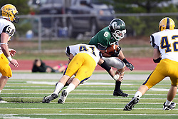 12 November 2011:  Erik Westerberg dives for ball carrier Joe Musso during an NCAA division 3 football game between the Augustana Vikings and the Illinois Wesleyan Titans in Tucci Stadium on Wilder Field, Bloomington IL
