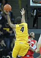 January 07, 2011: Iowa Hawkeyes guard/forward Roy Devyn Marble (4) puts up a shot over Ohio State Buckeyes forward Jared Sullinger (0) during the the NCAA basketball game between the Ohio State Buckeyes and the Iowa Hawkeyes at Carver-Hawkeye Arena in Iowa City, Iowa on Saturday, January 7, 2012.