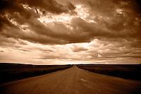 Sepia Print, low storm clouds above empty highway, Saskatchewan