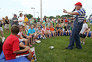 Sean Carlock (right) entertains the crowd at the 21st annual Tanager Place Summer Fest at the Rockwell Collins Sports Complex in Cedar Rapids on Saturday afternoon, June 4, 2011. Activities included the General Mills Make-Your-Own Cereal Tent, miniature golf, St. Luke's Hospital bike helmet giveaway, Video Game Etc tent, forty free kids' crafts and displays, a car show, and music. All proceeds from the event went to Tanager Place.