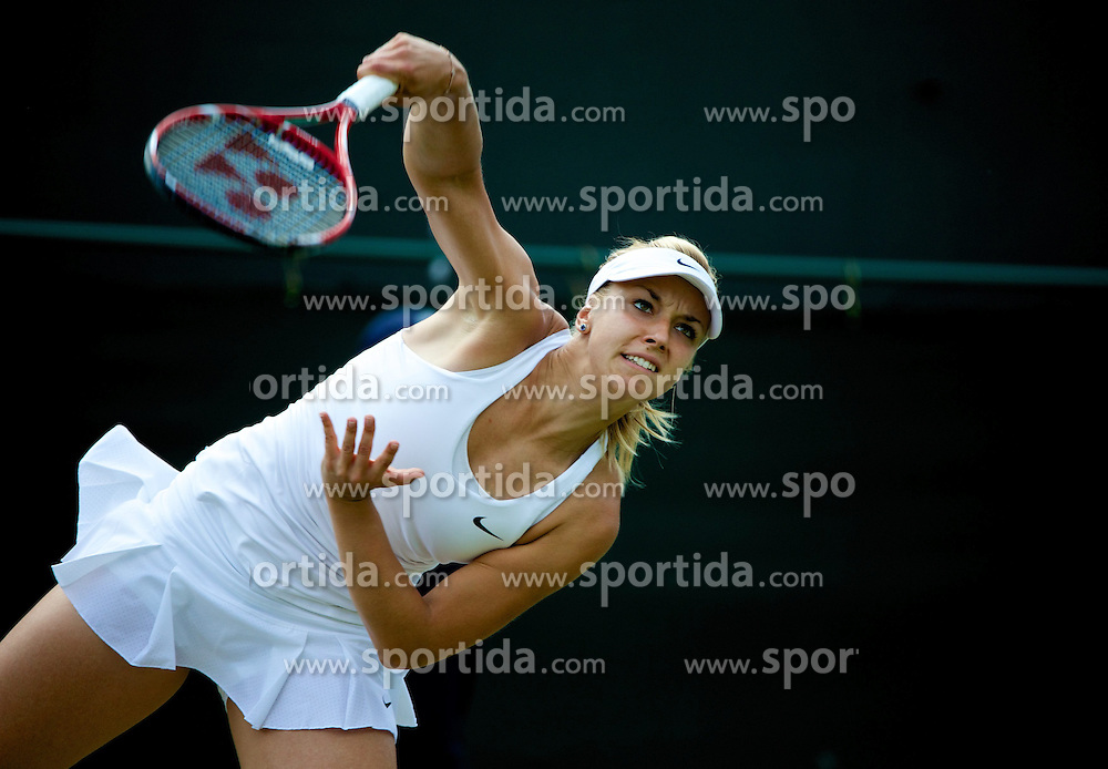 01.07.2014, All England Lawn Tennis Club, London, ENG, WTA Tour, Wimbledon, Tag 8, im Bild Sabine Lisicki (GER) //during day 8 the Wimbledon Championships at the All England Lawn Tennis Club in London, Great Britain on 2014/07/01. EXPA Pictures &copy; 2014, PhotoCredit: EXPA/ Propagandaphoto/ David Rawcliffe<br /> <br /> *****ATTENTION - OUT of ENG, GBR*****