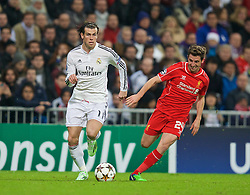 MADRID, SPAIN - Tuesday, November 4, 2014: Real Madrid's Gareth Bale in action against his  Wales international team-mate Liverpool's Joe Allen during the UEFA Champions League Group B match at the Estadio Santiago Bernabeu. (Pic by David Rawcliffe/Propaganda)