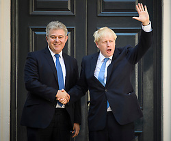 © Licensed to London News Pictures. 23/07/2019. London, UK. BORIS JOHNSON is greeted by Party Chairman BRANDON LEWIS as he arrives at Conservative Party headquarters. Today the Conservative Party Elected Boris Johnson as their new leader and Prime Minister, following Theresa May's announcement that she will step down. Photo credit: Ben Cawthra/LNP