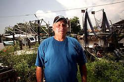 07 June 2010. Pointe aux Chenes, Louisiana.<br /> Fading away. Myron Prosterie, a shrimper, crabber, oysterman, fisherman and one time oil worker. Myron holds over $1,700 worth of various fishing permits issued by the state. At present, all his fishing grounds are closed. He can not make use of any of the permits and he can not earn the money to make up the money. Widowed eight months ago, Myron is a member of the Pointe aux Chenes Indians, settlers that can trace their roots beyond 5 gererations back to France. French cajun is the language of the elders, but is dying out in the children of today. BP's catastrophic oil spill threatens the tribe's very existance, their way of life and the land on which they live. Not recognised by the federal government, the 680 member tribe struggles for funds in a small community that survives only because of fishing and oil extraction in the Gulf of Mexico.<br /> He knows his life will never be the same again. The ecological and economic impact of BP's oil spill is devastating to the region. Oil from the Deepwater Horizon catastrophe is evading booms laid out to stop it thanks in part to the dispersants which means the oil travels at every depth of the Gulf and washes ashore wherever the current carries it. The Louisiana wetlands produce over 30% of America's seafood and oil and gas production. They are the most fertile wetlands and nurseries of their kind in the world.<br /> Photo; Charlie Varley/varleypix.com
