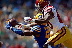 BERKELEY, CA - SEPTEMBER 23:  Cornerback Josh Drayden #20 of the California Golden Bears intercepts a pass intended for wide receiver Deontay Burnett #80 of the USC Trojans during the second quarter at California Memorial Stadium on September 23, 2017 in Berkeley, California. (Photo by Jason O. Watson/Getty Images) *** Local Caption *** Josh Drayden; Deontay Burnett