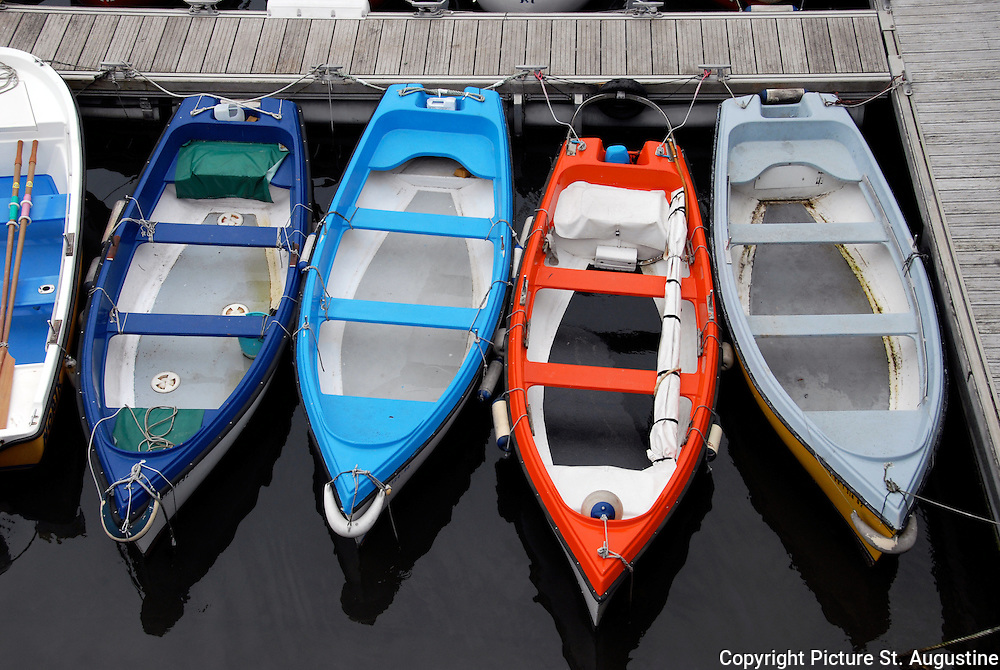 Colorful small fishing boats at the dock in San Sebastian, Spain.