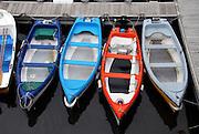 Colorful small fishing boats at the dock in San Sebastian, Spain.