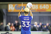 AFC Wimbledon striker Lyle Taylor (33) celebrating with match ball during the EFL Sky Bet League 1 match between AFC Wimbledon and Rotherham United at the Cherry Red Records Stadium, Kingston, England on 17 October 2017. Photo by Matthew Redman.