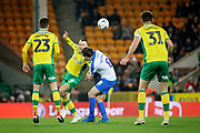 Norwich City midfielder Tom Trybull (19) and Portsmouth forward Brett Pitman (8) on the ball during the The FA Cup 3rd round match between Norwich City and Portsmouth at Carrow Road, Norwich, England on 5 January 2019.