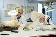 Ercolano, Italia - 23 novembre 2012. I restauratori Giusepe Farella  (sx) e Antonio Russo al lavoro in un laboratorio all'interno degli scavi archeologici di Ercolano (Herculaneum). Il sito archologico di epoca romana, patrimonio dell'Unesco, distante solo pochi km da Pompei, ha riportato alla luce tesori antichi di inestimabile valore. A differenza di Pompei, ad Ercolano sono stati ritrovati reperti organici ed in legno che hanno permesso agli archeologi di studiare in modo più approfondito le abitudini dell'epoca. Ph. Roberto Salomone Ag. Controluce.ITALY - Restorers Giuseppe Farella(L) and Antonio Russo  work in a lab inside the archeological site of Herculaneum on November 23, 2012. The world heritage site of roman age, just a few miles away from Pompeii has brought to life treasures that made it possible for archeologists to study in a more detailed way the lifestyle of ancient romans.