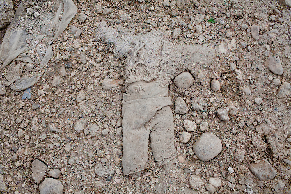 A doll lies in the dirt on July 13, 2010 in the Fort National neighborhood in Port-au-Prince, Haiti.
