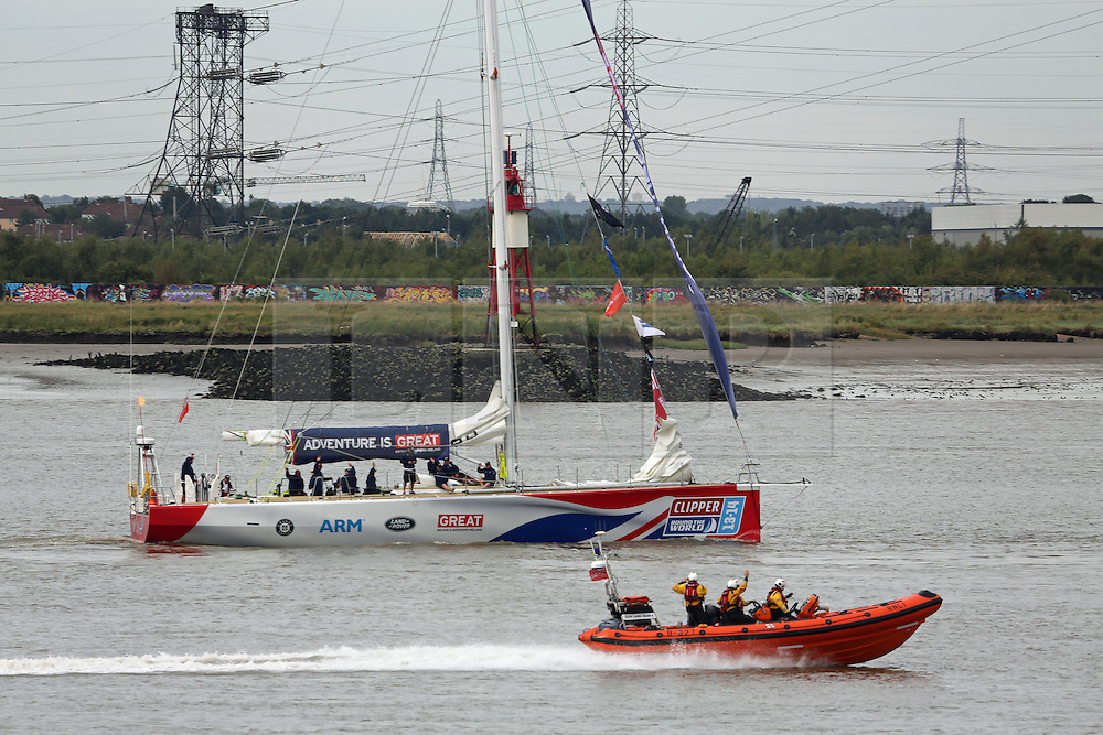 © Licensed to London News Pictures. 01/09/2013.  Photos of vessels taking part in the Clipper Race. The 11-month round the world race started today at Tower Bridge. The local RNLI wave at the GB team boat at Greenhithe. Credit : Rob Powell/LNP