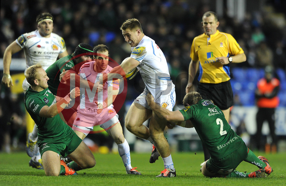 Exeter Chiefs' Inside Centre, Sam Hill is challenged by London Irish hooker, David Price - Photo mandatory by-line: Dougie Allward/JMP - Mobile: 07966 386802 - 11/01/2015 - SPORT - RUGBY - Reading - Madejski Stadium - London Irish v Exeter Chiefs - Aviva Premiership