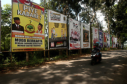 March 29, 2019 - Semarang, Java, Indonesia - Motorists pass a poster Chief of Berkarya party Hutomo Mandala Putra alias Tommy Suharto, son of former president Suharto at Pramuka Street In Semarang, Central Java Province on March 29, 2019, ahead of the presidential and legislative elections. Indonesia is set to hold simultaneous presidential and parliamentary elections on April 17. (Credit Image: © Wf Sihardian/NurPhoto via ZUMA Press)