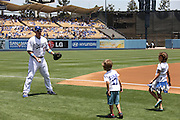 LOS ANGELES, CA - JUNE 15:  A.J. Ellis #17 of the Los Angeles Dodgers plays catch with his children before the Father's Day game against the Arizona Diamondbacks at Dodger Stadium on Sunday, June 15, 2014 in Los Angeles, California. The Diamondbacks won the game 6-3. (Photo by Paul Spinelli/MLB Photos via Getty Images) *** Local Caption *** A.J. Ellis