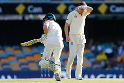 England's Chris Woakes looks dejected as Australia's Cameron Bancroft piles on the runs during day four of the Ashes Test match at The Gabba, Brisbane.
