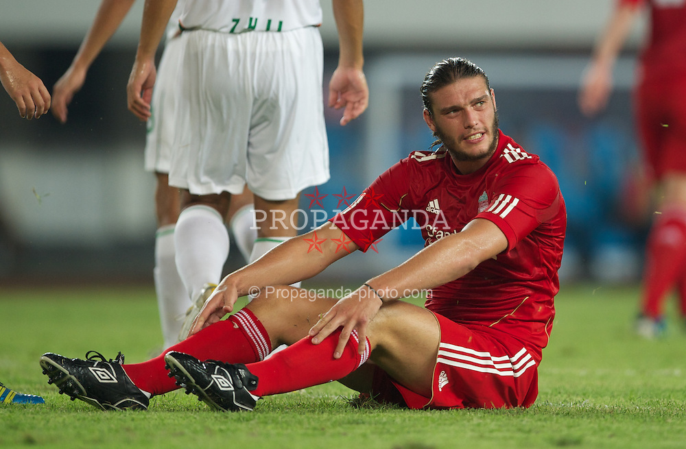 GUANGZHOU, CHINA - Wednesday, July 13, 2011: Liverpool's Andy Carroll in action against Guangdong Sunray Cave during the first pre-season friendly on day three of the club's Asia Tour at the Tianhe Stadium. (Photo by David Rawcliffe/Propaganda)