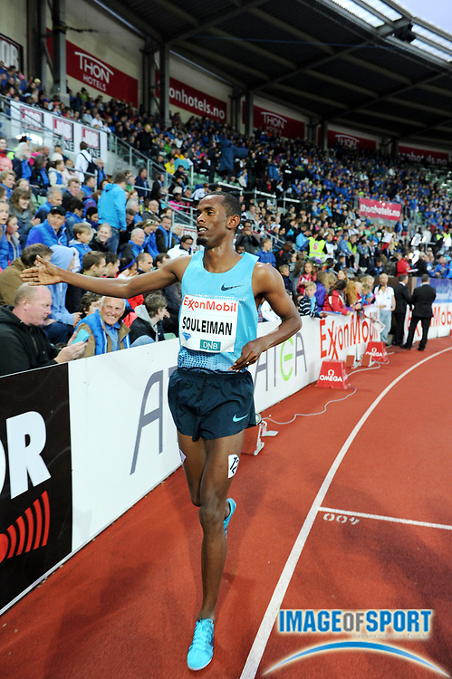 Jun 13, 2013; Oslo, NORWAY; Ayanleh Souleiman (DJI) takes a victory lap after winning the dream mile in 3:50.53 in the 2013 ExonMobil Bislett Games at Bislett Stadium. Photo by Jiro Michozuki
