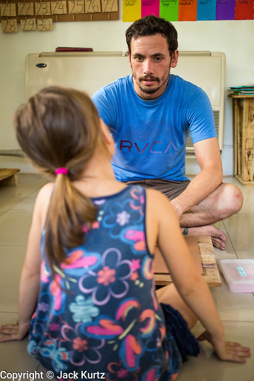 01 APRIL 2013 - BANGKOK, THAILAND:   Tim Hupe teaches his daughter Arielle, 4, in the school in their home.  PHOTO BY JACK KURTZ