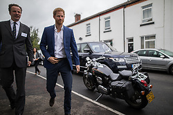 © Licensed to London News Pictures . 04/09/2017 . Manchester , UK . Prince Harry visits the Walking With the Wounded ( WWTW) hub on Canada Street , Newton Health .  WWTW helps ex-service personnel with physical or mental health needs make the transition back to civilian life . Photo credit : Joel Goodman/LNP