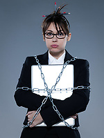 beautiful business woman on isolated bacground chained to  her computer laptop
