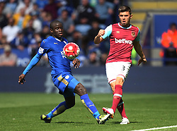 Ngolo Kante of Leicester City (L) and Aaron Cresswell of West Ham United in action - Mandatory by-line: Jack Phillips/JMP - 17/04/2016 - FOOTBALL - King Power Stadium - Leicester, England - Leicester City v West Ham United - Barclays Premier League