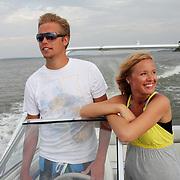 Anna Janssen and boyfriend Austin Ewell enjoy a boat ride on Red Rock Lake in central Iowa.