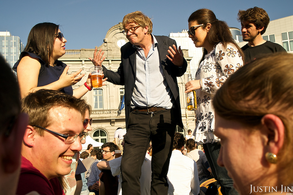 People gather for drinks outside the EU Parliament after work.
