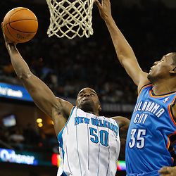 January 24,  2011; New Orleans, LA, USA; New Orleans Hornets center Emeka Okafor (50) dunks over Oklahoma City Thunder small forward Kevin Durant (35) during the second quarter at the New Orleans Arena. Mandatory Credit: Derick E. Hingle
