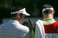 PGA rookie, Bubba Watson, talks with his caddie, Ted Scott, during the first day of the Pro-Am while at Forest Oaks in Greensboro, NC Monday morning October 2nd, 2006. Scott has been a pro caddie for six years but has only been with Watson for three weeks.&amp;#xD;Photo by David Duncan&amp;#xD;<br />