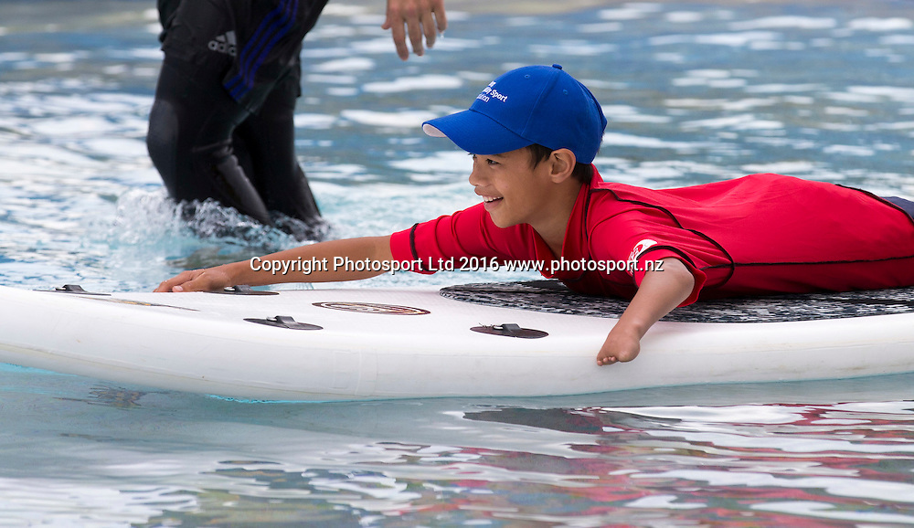 Weighn Wilson, gives SUP a try. Flight Centre Foundation Halberg Water Sports Day, Waikanae Beach, Gisborne, New Zealand. Saturday, 26 November, 2016. Copyright photo: John Cowpland / www.photosport.nz