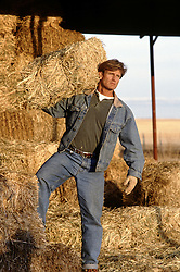 All American rancher with hay bales