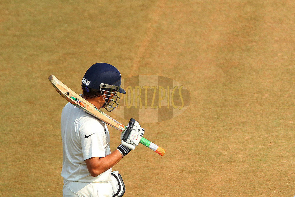 Sachin Tendulkar of India with his bat handle in Indian colours during day two of the second Star Sports test match between India and The West Indies held at The Wankhede Stadium in Mumbai, India on the 15th November 2013<br /> <br /> This test match is the 200th test match for Sachin Tendulkar and his last for India.  After a career spanning more than 24yrs Sachin is retiring from cricket and this test match is his last appearance on the field of play.<br /> <br /> <br /> Photo by: Ron Gaunt - BCCI - SPORTZPICS<br /> <br /> Use of this image is subject to the terms and conditions as outlined by the BCCI. These terms can be found by following this link:<br /> <br /> http://sportzpics.photoshelter.com/gallery/BCCI-Image-Terms/G0000ahUVIIEBQ84/C0000whs75.ajndY